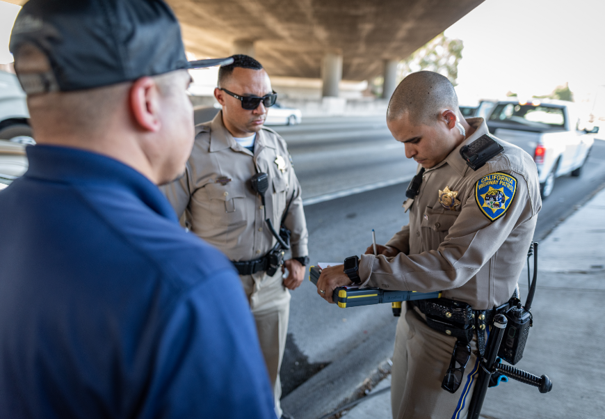 Photo of Two Officers Giving a Citation